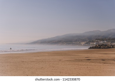 Haze is getting over mountains. Santa Monica beach, California, U.S.