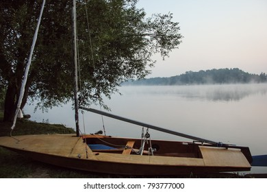haze over the lake at sunrise with boat