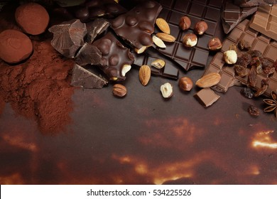 Hazelnut and almond chocolate, spices and truffles on cocoa powder