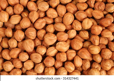 Hazelnut Background. Heap of peeled hazelnuts.