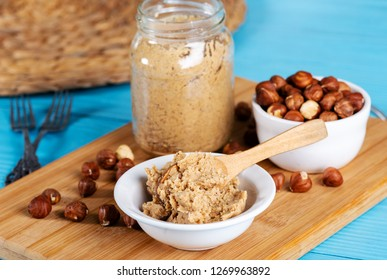 Hazelnut butter on wooden background