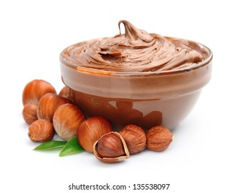 Hazelnut cream with hazelnut nuts isolated on white