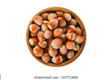 Hazelnut. Hazelnut isolated on white background. Top view. Nut hazelnuts in a wooden bowl. Isolate nuts.