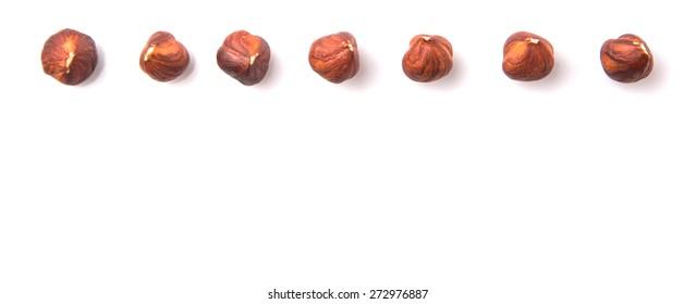 Hazelnut over white background