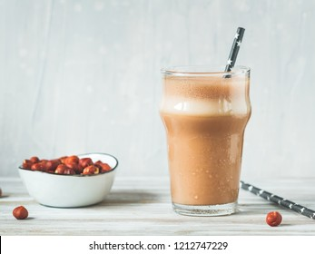 Hazelnut protein shake in a glass. The concept of a healthy lifestyle and fitness diet.