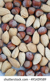 hazelnuts and almonds in the shell background 3