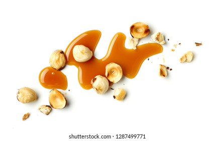 hazelnuts and caramel sauce isolated on white background, top view