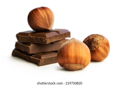 hazelnuts and chocolate isolated on white close -up