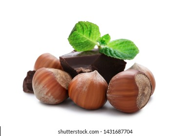 Hazelnuts with chocolate and mint leafs isolated on white background