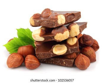 Hazelnuts chocolate on white close up