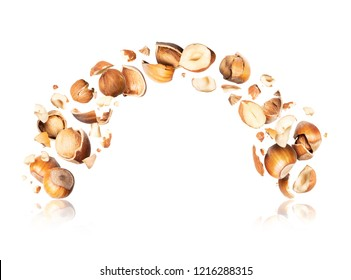Hazelnuts crushed in the air on white background