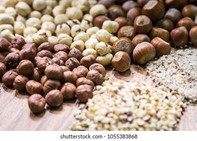 hazelnuts of different types on a wooden plate. healthy foods. soft focus