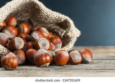 Hazelnuts, filbert on old wooden table. heap or stack of hazel nuts. Hazelnut background, healty food