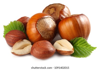 hazelnuts with leaves isolated on white background. macro