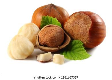 hazelnuts with leaves isolated on white background. macro