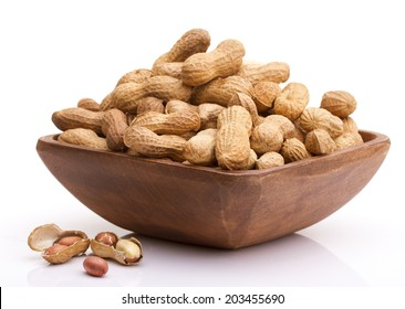 Hazelnuts on a Bowl against White Background