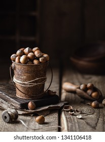 Hazelnuts on rustic wooden background. Food background
