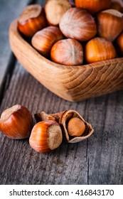 Hazelnuts on a wooden background.
