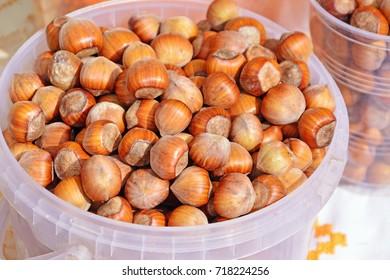 Hazelnuts in plastic buckets at the market