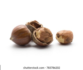 Hazelnuts shelled and unshelled brown isolated on white background
