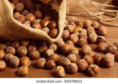Hazelnuts in a yuta bag on wooden table