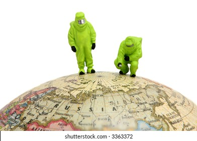 HAZMAT in protective gear on globe. Can represent global warming, chemical warfare, or pollution.