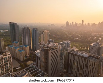A hazy afternoon in Metro Manila. The BGC and Makati skylines separated by Manila Golf Country Club and Forbes Park.