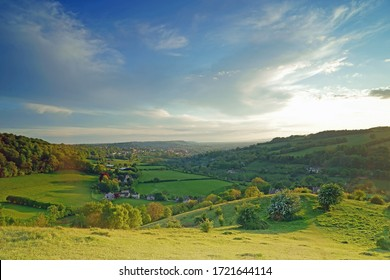 A hazy end to a beautiful spring day looking towards the Cotswold town of Stroud from Swifts Hill, Slad, Gloucestershire, Uk