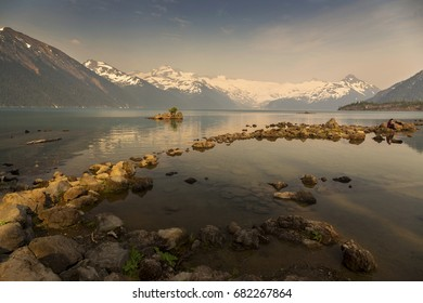Hazy Garibaldi Lake Landscape and Distant Snowy Mountain Tops obscured by smoke from BC Forest Fires in Coast Mountains of British Columbia Canada