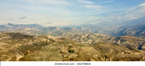 Hazy landscape with mountains and valleys of Sierra Nevada, Andalusia, Spain