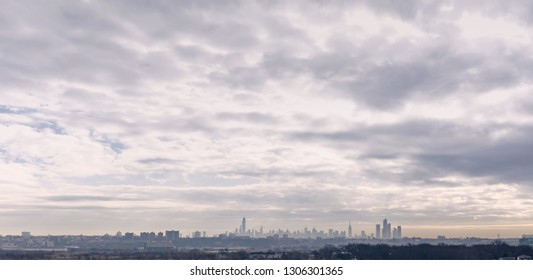 Hazy morning view of New York City in the distance.