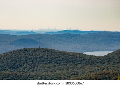Hazy New York City skyline far in the distance over the Hudson Highlands, seen from the Mount Beacon Fire Tower