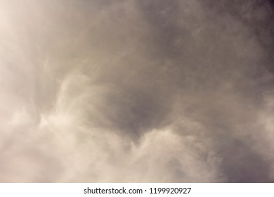 Hazy small cirrostratus, cirrocumulus and cumulus cloud formations on a sunny afternoon  in late autumn   create a filtered background effect.