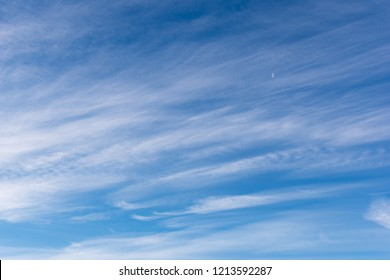 Hazy small cirrostratus, cirrocumulus and cumulus cloud formations at blue sky.