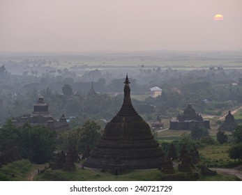Hazy sunset over Mrauk U in the northern part of the Rakhin State, Myanmar. Mrauk U was the capital of the Mrauk U Kingdom from 1430 to 1785.