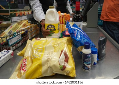 Hazyview, South Africa - August 05, 2019:  paying for a selection or variety of brand products or grocery items at a checkout counter in a supermarket or food store concept lifestyle and daily life