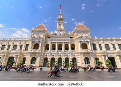HCMC,VIETNAM - JAN 26: many Unidentified riders ride motorbikes in front of The Peoples' Committee building on Jan 26,2016 in Ho Chi Minh Square. It ismost iconic building and known as Hotel de Ville.