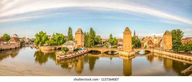 HD panorama from the top of the Barrage Vauban with the towers along the  over the river Ill and the Cathedral de Strasbourg in the background. Petit France, Strasbourg, Alsace, France