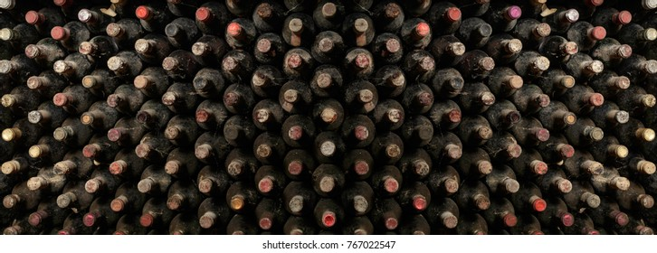HD wall panel portraying a large number of old wine bottles stored in a cellar for aging