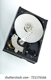 HDD Hard disk drive opened on white background