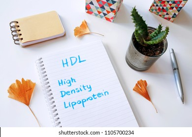 HDL High-density lipoprotein written in notebook on white table