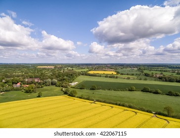 HDR aerial view of canola and agriculture fields on a sunny day