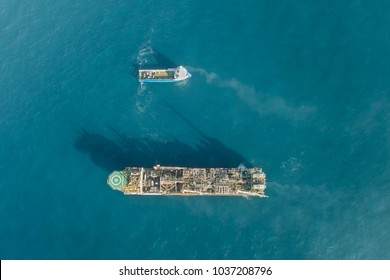 HDR Aerial view of an offshore oil platform and supply ship