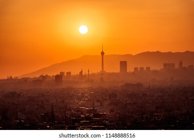 HDR cityscape of theran city with milad tower in the middle-sunset of tehran-telephoto HDR