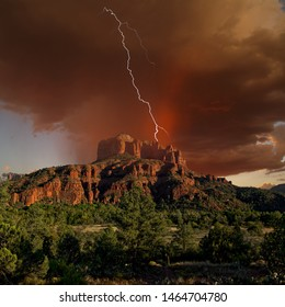 HDR composite of a storm cell rolling over Cathedral Rock in Sedona Arizona near sundown. Composed of 3 exposures. One for the landscape. One for the storm, and one for the lightning.
