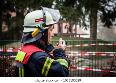HDR - Firefighter operate with a walkie talkie in action - Serie Firefighter