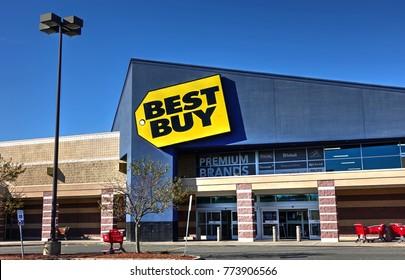 HDR image, Best Buy electronics retailer storefront sign, shopping center - Danvers, Massachusetts USA - October 18, 2017