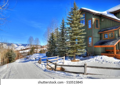 HDR image of colorful houses covered with snow in Snowmass, near Aspen Colorado on a clear day