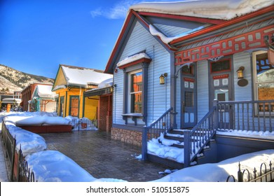 HDR image of colorful houses and shops covered with snow in Aspen Colorado on a clear day