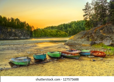 The HDR image of fishermen's berth on Biya river coast in Turochak village (Altai republic, Russia)